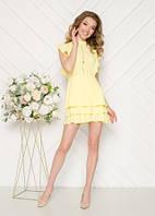Нарядное платье желтого цвета с воланами
