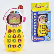 7028 Музыкальный развивающий Умный телефон на батарейках: учит цифрам, буквам, фигурам в коробке 29*13*5 см