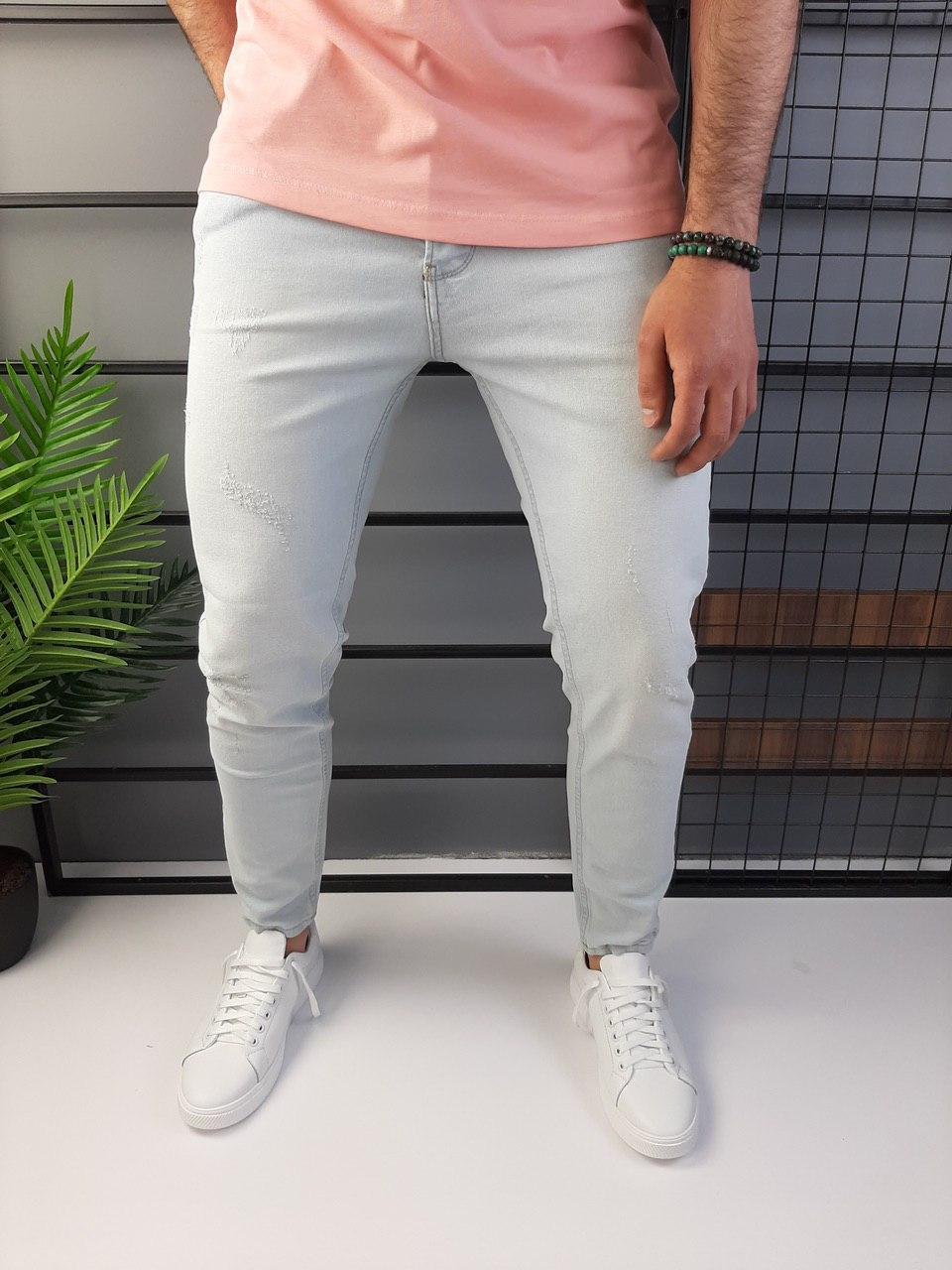 Чоловічі джинси завужені світло-сірі з подряпинами