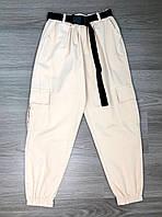 Женские брюки КАРГО  с  высокой посадкой,по бокам карманы с обеих сторон. Стильно. Модно.