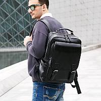 Широкий черный рюкзак два основных отделения и много дополнительных карманов