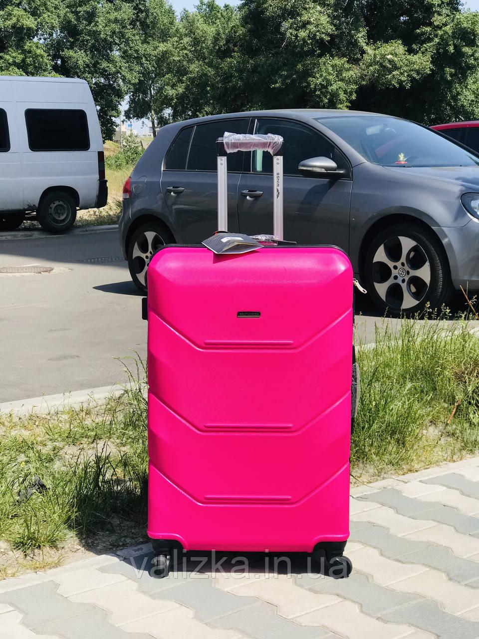 Пластиковый чемодан из поликарбоната средний розового цвета Польша