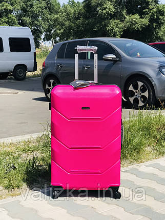 Пластиковый чемодан из поликарбоната средний розового цвета Польша, фото 2