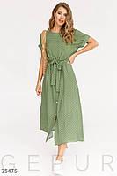 Темно-зеленое платье в констрастный горошек