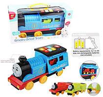 Муз.паровоз   в наборе мал.паров.,батар.,свет,звук,в коробке 38,5*20*14см