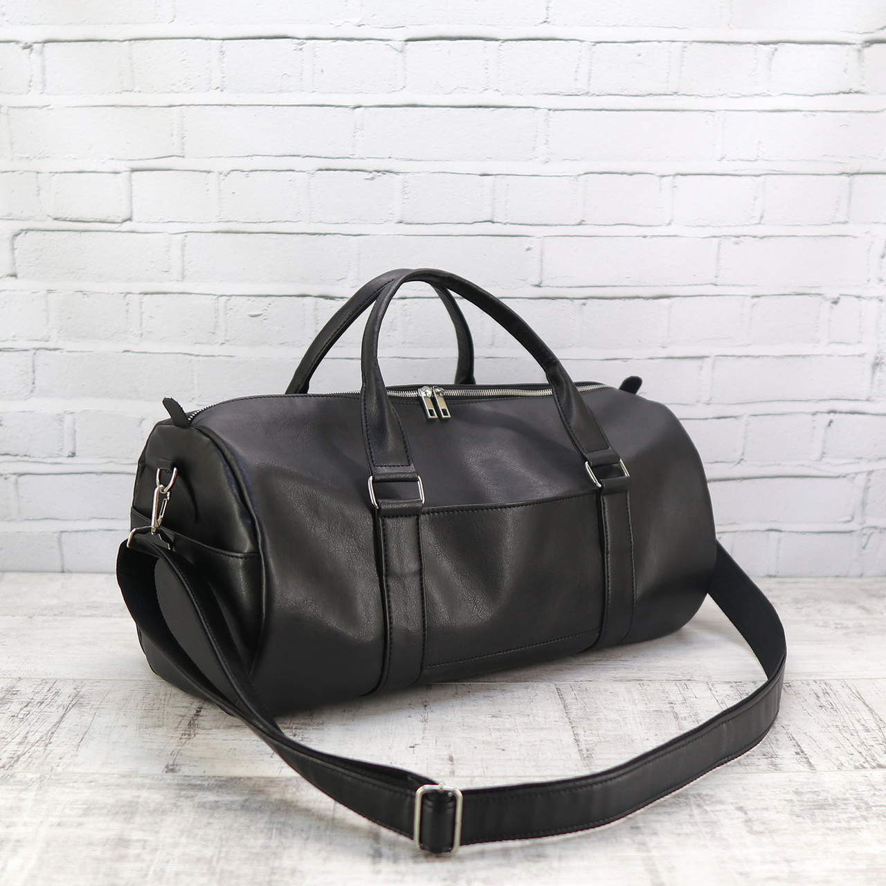 Дорожная сумка tube mini черная из эко кожи