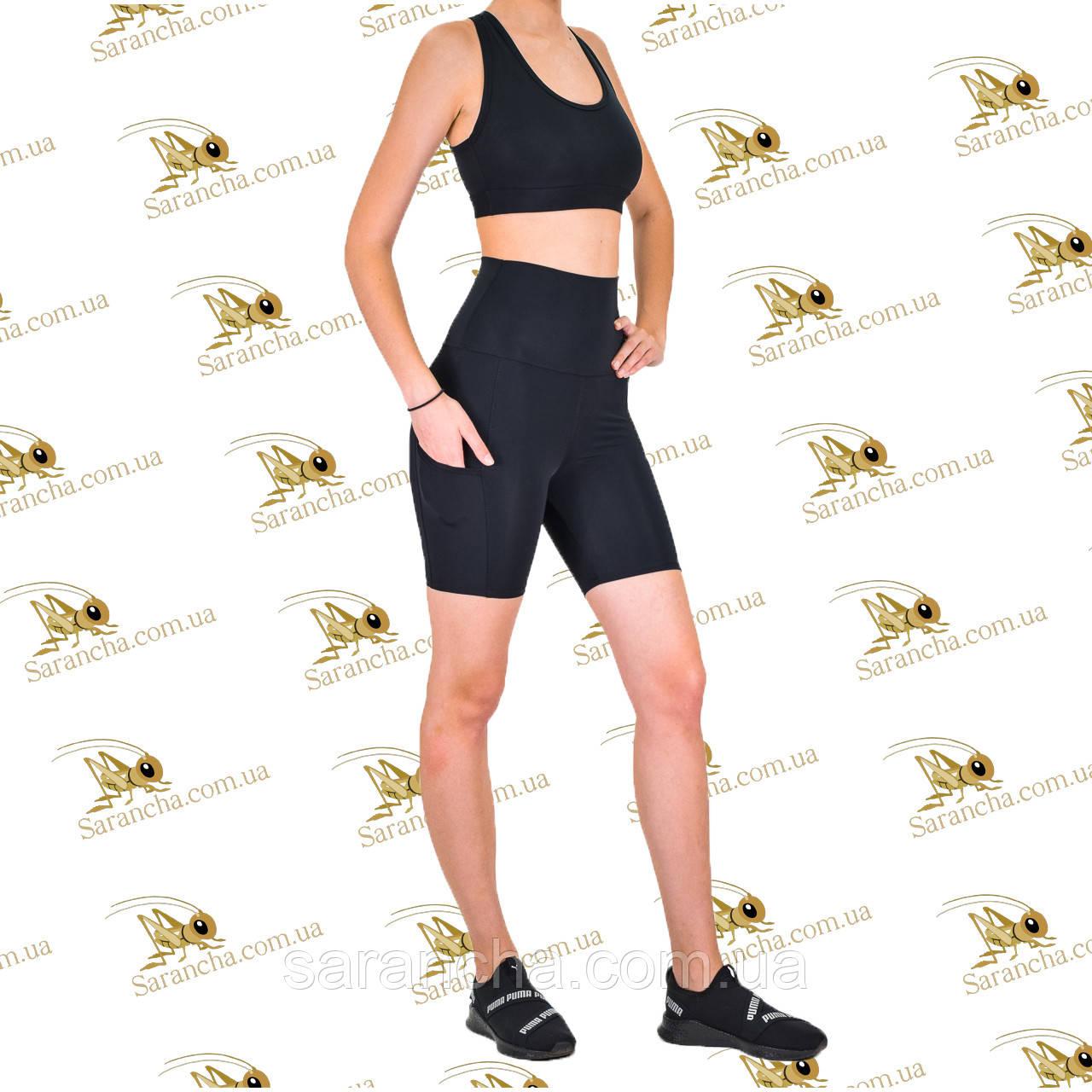 Жіночий спортивний комплект шорти-велосипедки з кишенями і топ чорного кольору