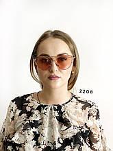 Сонцезахисні рожеві окуляри в срібній оправі