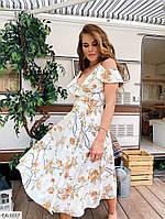 Женское платье с рюшами на запах