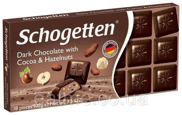 Schogetten Чёрный шоколад с кусочками какао и фундука