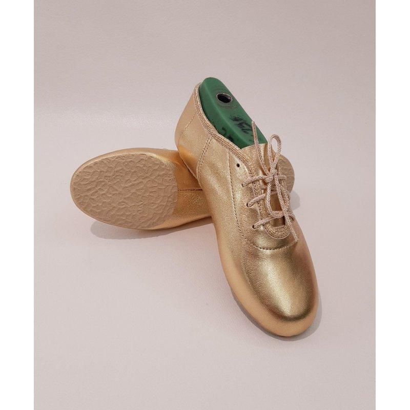 Кожаные джазовки на шнурках золотые