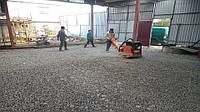 Уплотнение грунта основания, трамбование трамбовка грунта, песка щебня