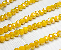 Бусины хрустальные (Рондель)  6х4мм пачка - 95-105 шт, непрозрачные желтые с АБ
