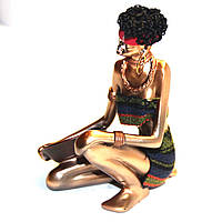 Статуэтка сидящей африканки 90010 C