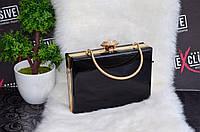Красивая черная сумка-клатч.