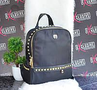 Женский рюкзак с заклепками и кожаными ручками
