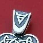 Ухо для оберега с символом Велеса
