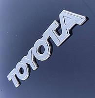 Эмблема - надпись TOYOTA 150*25 мм. Логотип на крышку багажника хромированный.