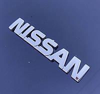 Эмблема - надпись NISSAN 120*20 мм. Логотип на крышку багажника хромированный.