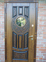 Двери входные металлические Круг со стеклом и ковкой