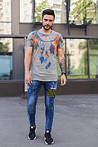 Мужские джинсы зауженные синего цвета с желтым, фото 3