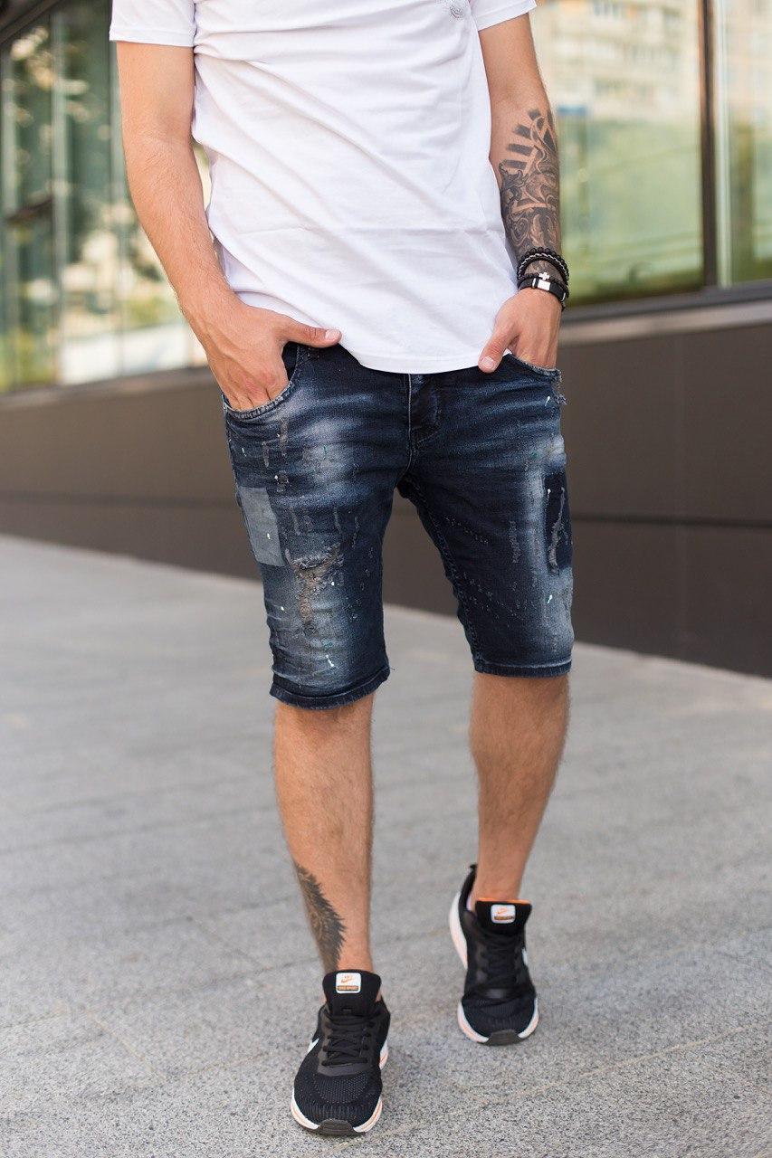 Мужские джинсовые шорты синего цвета с потертостями