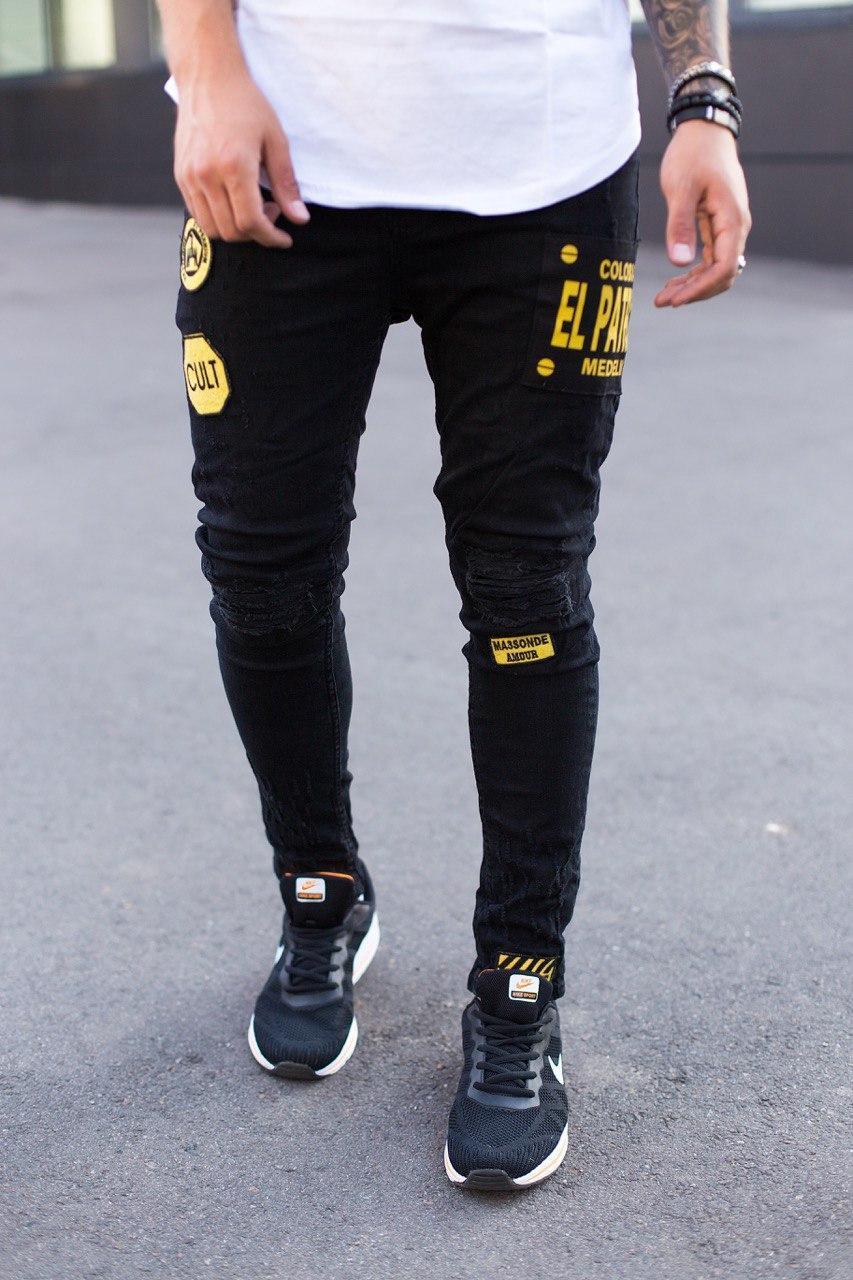 Чоловічі джинси завужені чорного кольору з жовтим