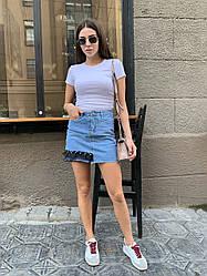 Стильна джинсова спідниця з кишенями оздоблена чорним фатином