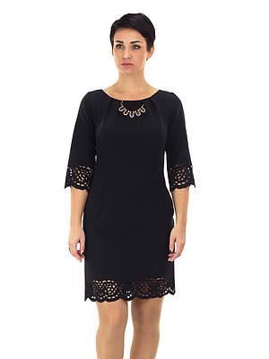 Нарядное черное женское платье с украшением