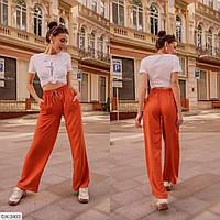 Женские брюки клеш на резинке с карманами