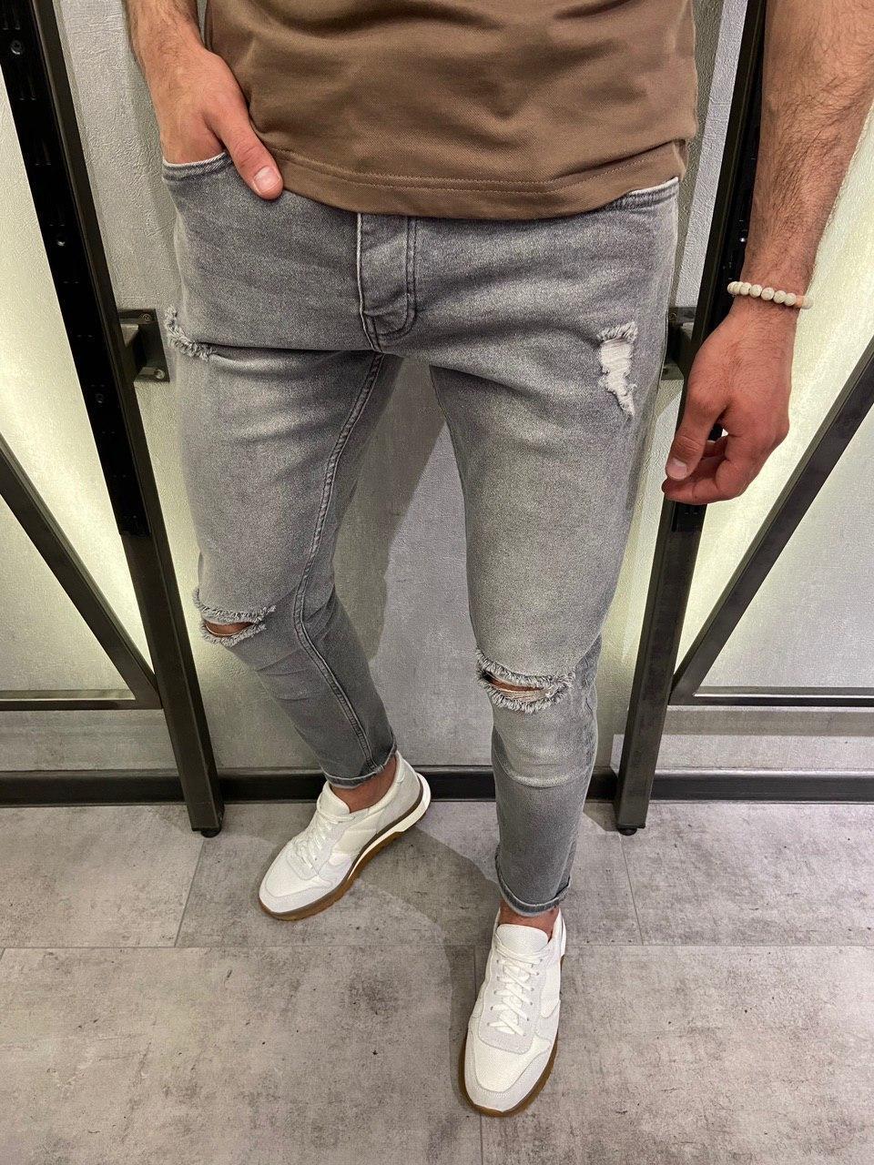 Чоловічі джинси завужені сірого кольору з розривами