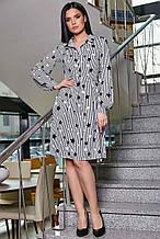 Черно-белое платье в полоску по колено с длинным рукавом и воротником. Летнее