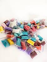 Трусики-стринги одноразовые Doily ис спанбонда разноцветные (100 шт. в тубусе)