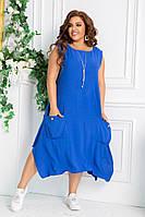 Женское стильное платье свободного кроя с большими карманами в дополнении с украшением