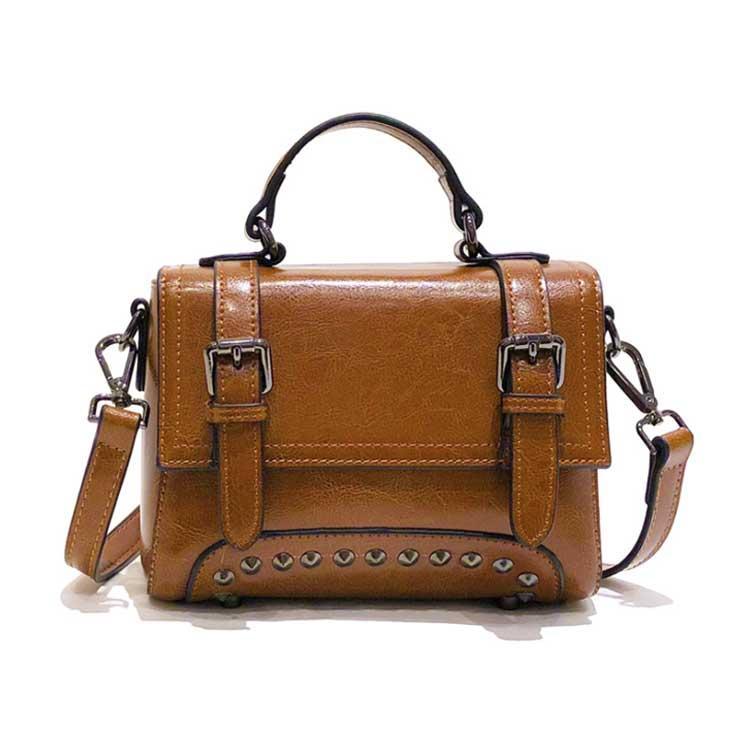 Жіноча шкіряна сумочка міні коричневого кольору