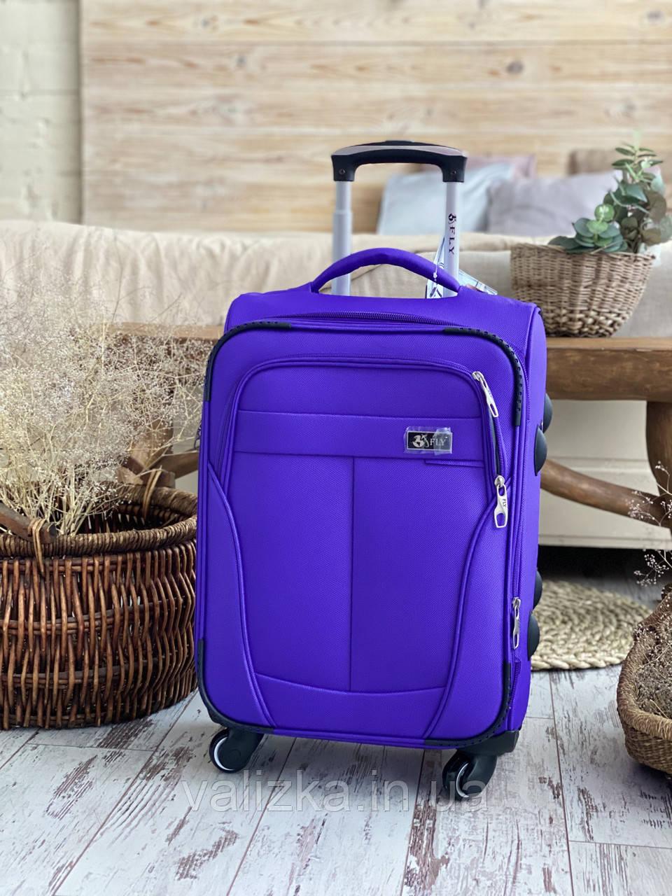 Средний текстильный чемодан тканевый 4 колеса фиолетовый