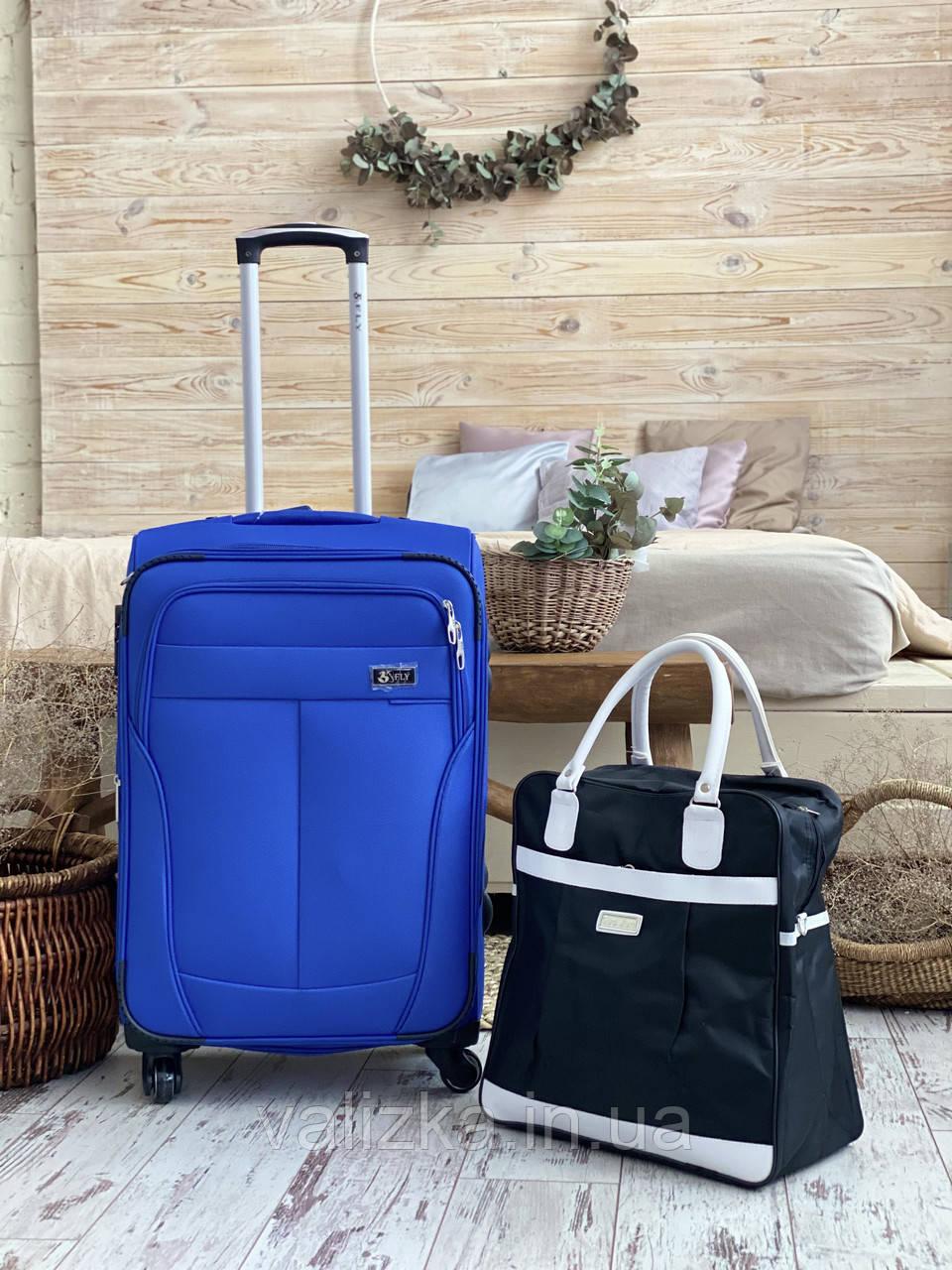 Средний текстильный чемодан тканевый 4 колеса синий