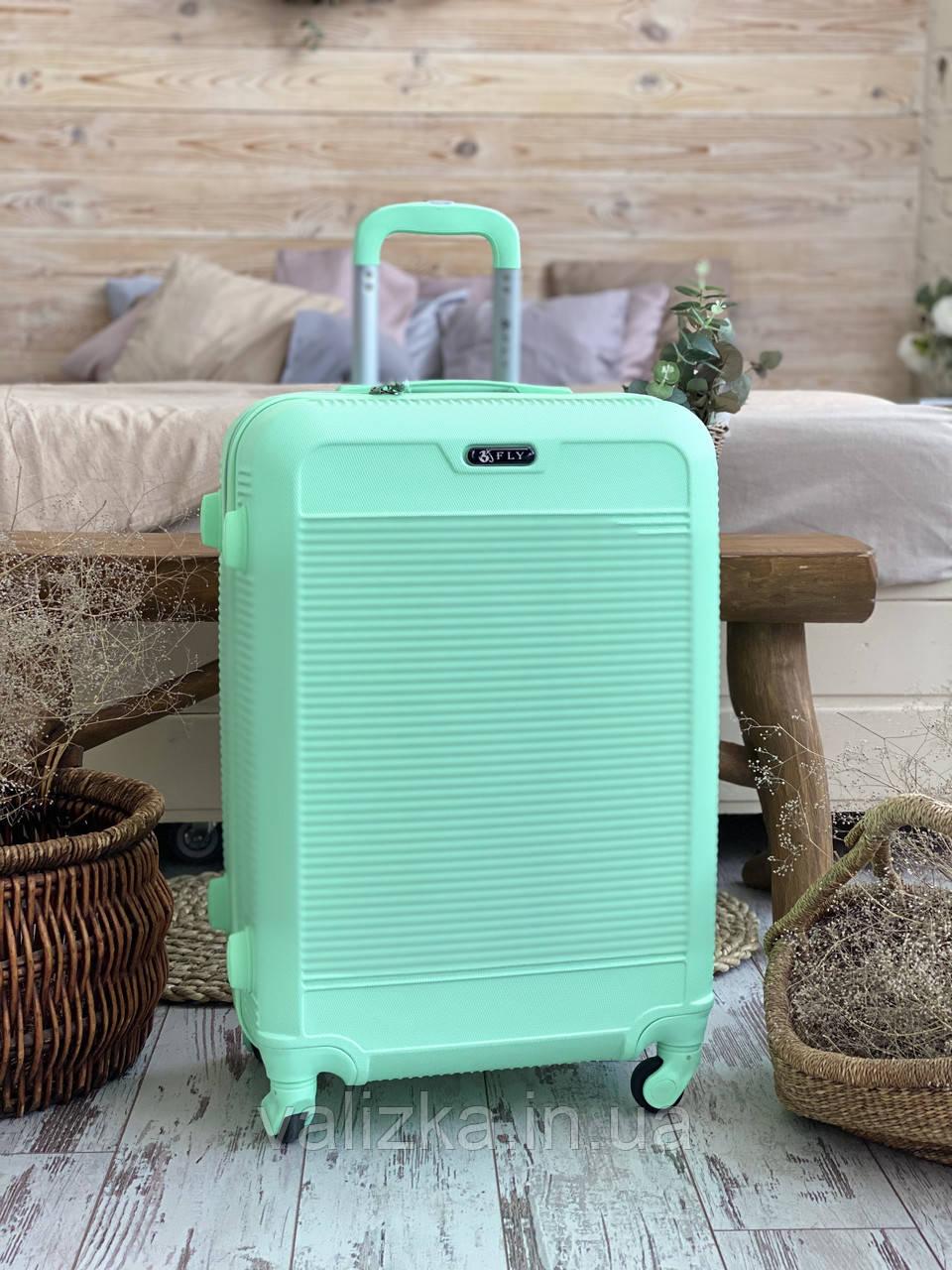 Большой пластиковый чемодан мятный на 4 колесах Польша