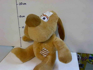 Мягкая игрушка Собака с латкой. pro