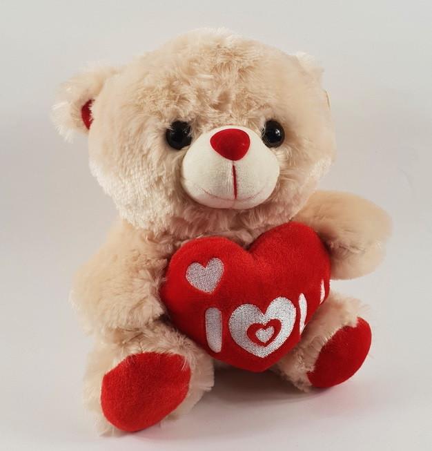 Мягкая игрушка Медведь с сердцем музыка 22 см