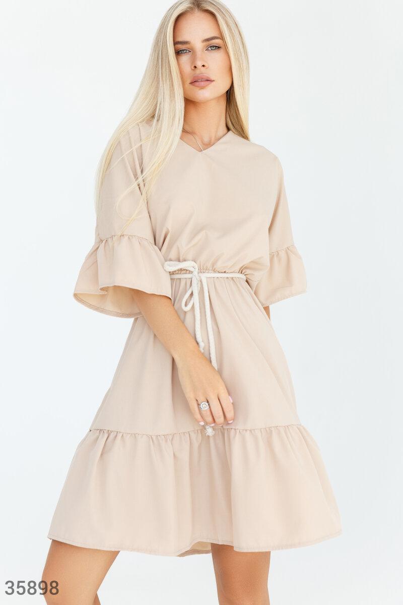 Приталене розкльошені сукні з воланами