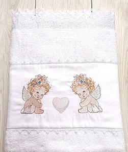 Крижма дитяча Волинські візерунки з ангелятами махрова 90*170 біла
