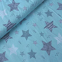 Тканина c візерунчастими зірками на бірюзовому, ширина 160 см