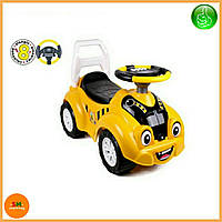 Детская желтая машинка - толокар (машинка-каталка) с электронным рулем, звуком