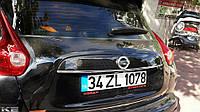 Nissan Juke 2010↗ гг. Хром планка над номером (нерж.) Carmos - Турецкая сталь
