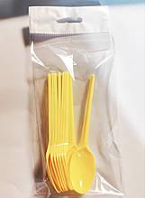 Пластикові одноразові ложки жовті 10 шт.