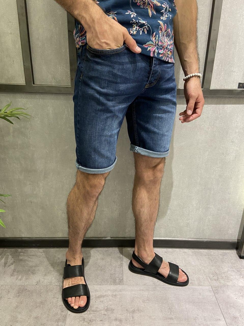 Чоловічі джинсові шорти синього кольору однотонні