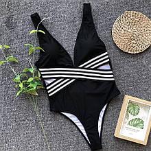 Черный слитный купальник с вырезами женский