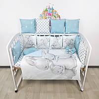 """Комплект бортиков и постельного в кроватку """"Зайки с мамой"""" с милыми зайчиками в нежно-голубых тонах."""