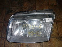 Фара ліва volkswagen polo 2000